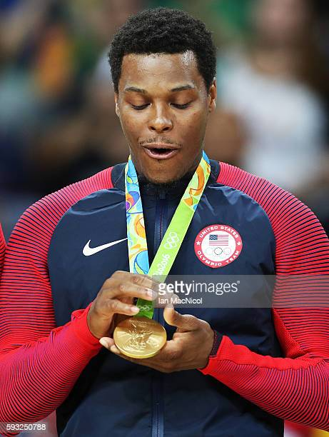 Kyle Lowry of the United States looks at his Gold medal after the final match of the Men's basketball between Serbia and United States on day 16 at...