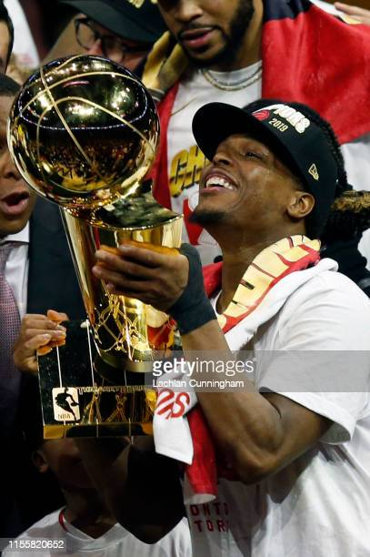 Kyle Lowry the Toronto Raptors celebrates with the Larry O'Brien Championship Trophy after his team defeated the Golden State Warriors to win Game...