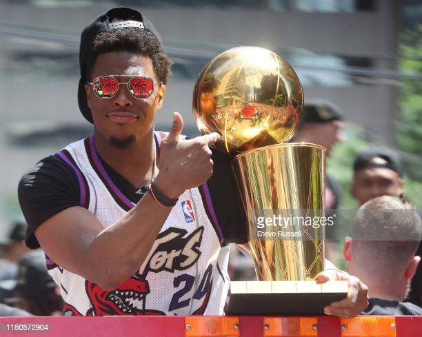 Kyle Lowry with the Larry O'Brien NBA Championship Trophy as the Toronto Raptors hold their victory parade after beating the Golden State Warriors in...