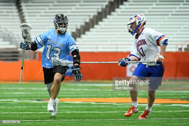 Kyle Marr of the Johns Hopkins Blue Jays controls the ball as Brett Kennedy of the Syracuse Orange defends during the second half at the Carrier Dome...