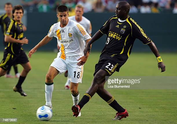 Kyle Martino of the Los Angeles Galaxy advances the ball against Ezra Hendrickson of the Columbus Crew at Home Depot Center on June 23, 2007 in...