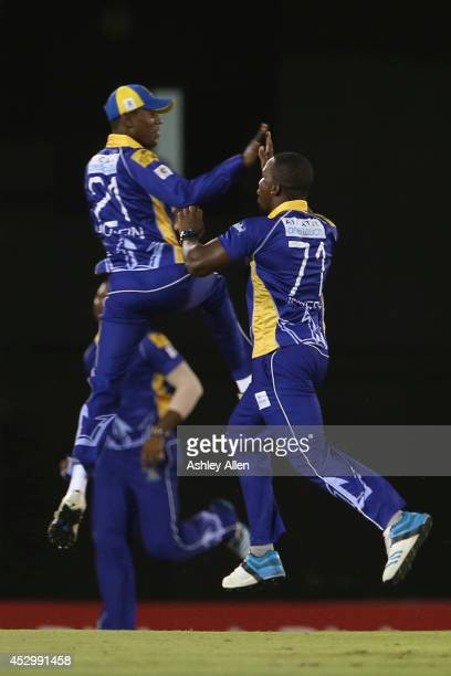 Kyle Mayers and Akeal Hosien celebrate during a match between St Lucia Zouks and Barbados Tridents as part of week 4 of the Limacol Caribbean Premier...