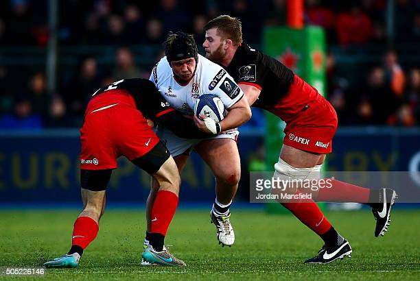 Kyle McCall of Ulster is tackled by Duncan Taylor and George Kruis of Saracens during the European Rugby Champions Cup match between Saracens and...