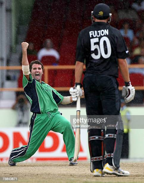 Kyle McCallan of Ireland celebrates the wicket of Peter Fulton of New Zealand during the ICC Cricket World Cup Super Eights match between Ireland and...