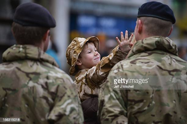 Kyle McClements 4 years old from Dundee joins soldiers from 19th Regiment Royal Artillery the Highland Gunners as they take part in a Homecoming...