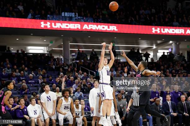 Kyle McCloskey of the Northwestern Wildcats shoots the ball while being guarded by Ryan Greer of the Penn State Nittany Lions during the second half...