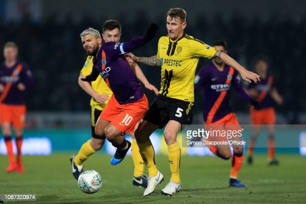 Kyle McFadzean of Burton fouls Sergio Aguero of Man City during the Carabao Cup Semi Final Second Leg match between Burton Albion and Manchester City...