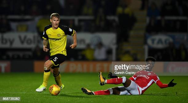 Kyle McFadzean of Burton gets past Ike Ugbo of Barnsley during the Sky Bet Championship match between Burton Albion and Barnsley at Pirelli Stadium...