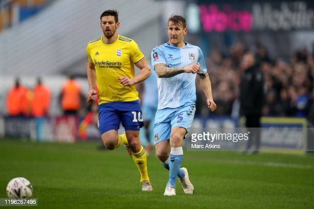 Kyle McFadzean of Coventry City in action with Lukas Jutkiewicz of Birmingham City during the FA Cup Fourth Round match between Coventry City and...