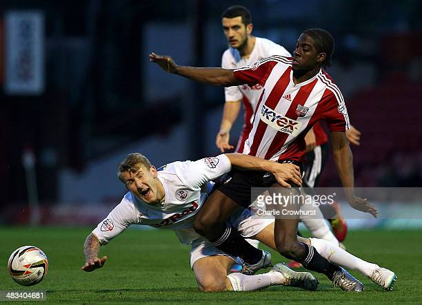 Kyle McFadzean of Crawley is fouled by Clayton Donaldson of Brentford during the Sky Bet League One match between Brentford and Crawley Town at...
