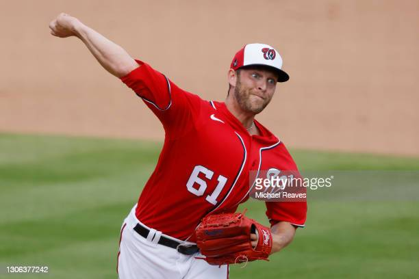 Kyle McGowin of the Washington Nationals delivers a pitch against the St. Louis Cardinals in the eighth inning of a Grapefruit League spring training...