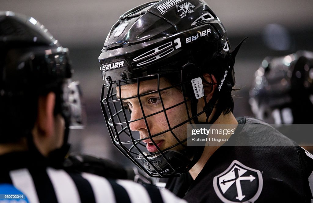 Kyle McKenzie #5 of the Providence College Friars talks to a referee during NCAA hockey against the Denver Pioneers at the Schneider Arena on December 30, 2016 in Providence, Rhode Island. The game ended in a 2-2 tie.