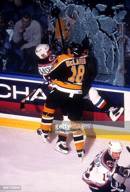 Kyle McLaren of the Boston Bruins checks Bryan Smolinski into the glass as it shatters on the impact during their game on February 1, 1998 at the...