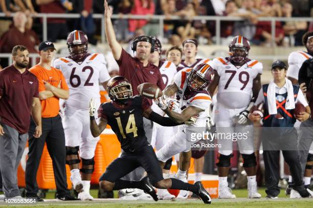 Kyle Meyers of the Florida State Seminoles breaks up a pass intended for Damon Hazelton of the Virginia Tech Hokies in the second quarter of the game...