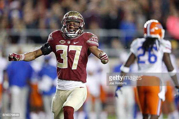 Kyle Meyers of the Florida State Seminoles celebrates against the Florida Gators in the third quarter of the game at Doak Campbell Stadium on...
