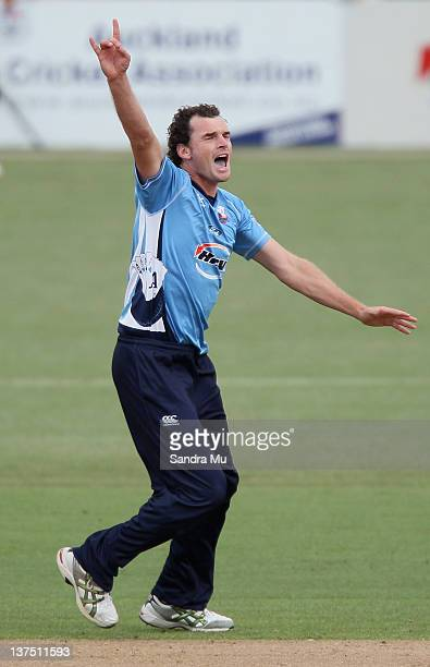 Kyle Mills of Auckland celebrates taking the last wicket to win the game during the HRV Cup match between the Auckland Aces and Canterbury Wizards at...