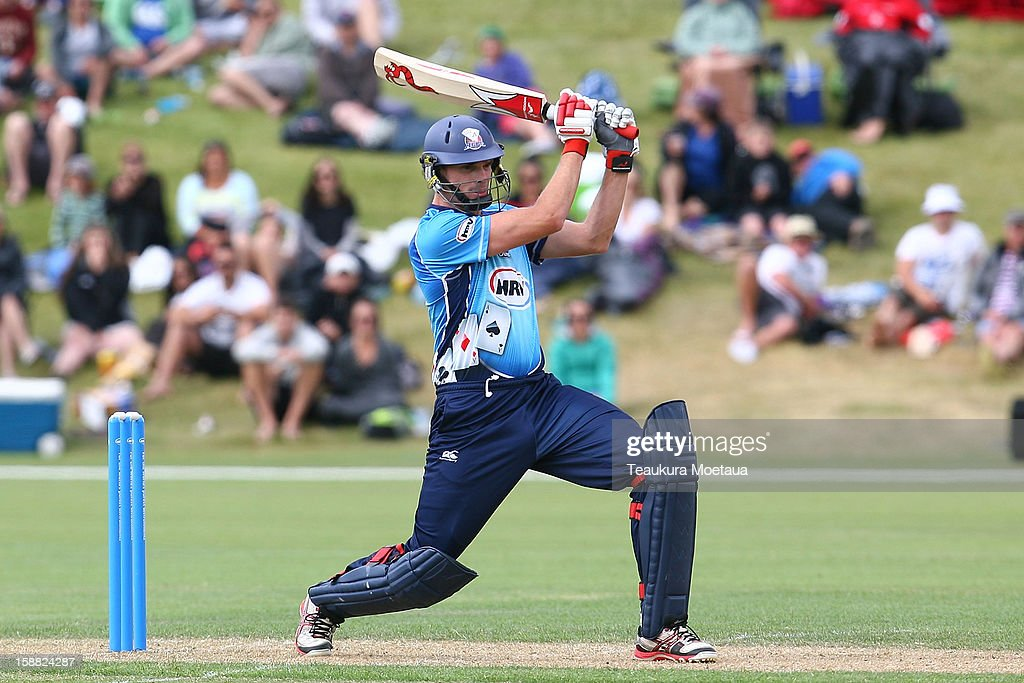 Kyle Mills of Auckland hits to the onside during the Twenty20 match between Otago and Auckland at Queenstown Events Centre on December 31, 2012 in Queenstown, New Zealand.