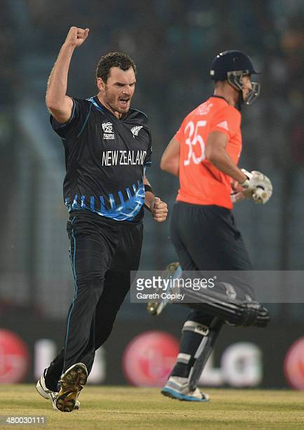 Kyle Mills of New Zealand celebrates dismissing Alex Hales of England during the ICC World Twenty20 Bangladesh 2014 group 1 match between England and...