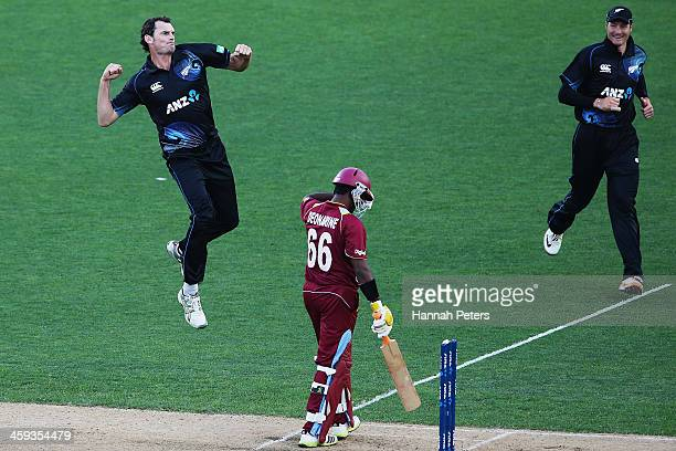 Kyle Mills of New Zealand celebrates the wicket of Narsingh Deonarine of the West Indies during the first One Day International match between New...