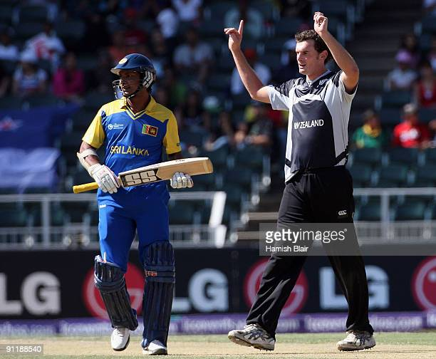 Kyle Mills of New Zealand celebrates the wicket of Tillakaratne Dilshan of Sri Lanka with Kumar Sangakkara of Sri Lanka looking on during the ICC...