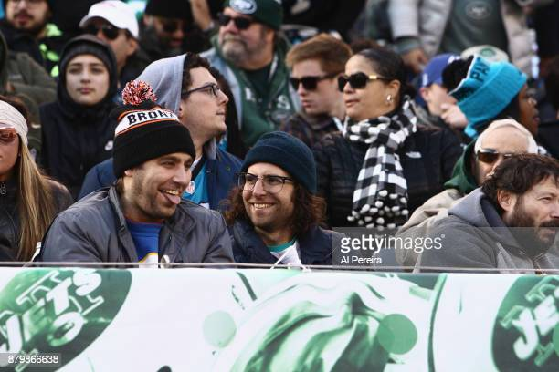 Kyle Mooney follows the action from the stands when he attends the Carolina Panthers vs New York Jets game at MetLife Stadium on November 26 2017 in...