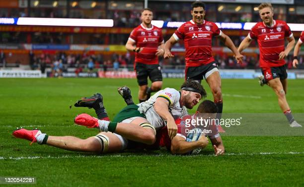 Kyle Moyle of Gloucester scores his side's third try as he is tackled by Ben Donnell of London Irish during the Gallagher Premiership Rugby match...