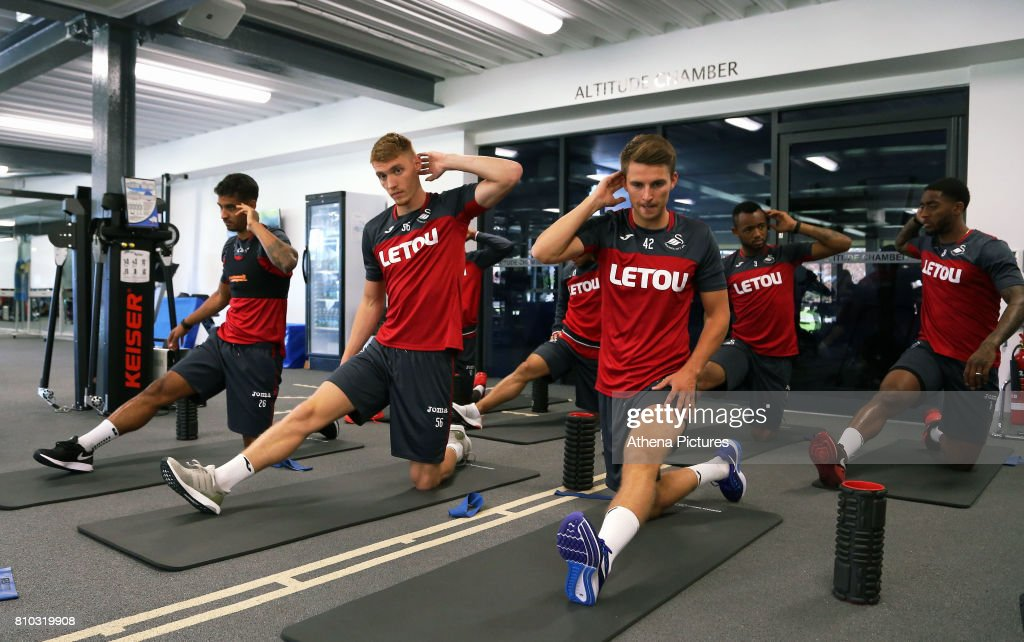 Kyle Naughton, Jay Fulton, Thomas Carroll, Jordan Ayew and Leroy Fer work out in the gym during the Swansea City Training at The Fairwood Training Ground on July 5, 2017 in Swansea, Wales.