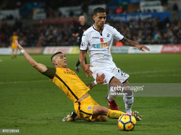 Kyle Naughton of Swansea City and Anthony Knockaert of Brighton and Hove Albion battle for possession during the Premier League match between Swansea...