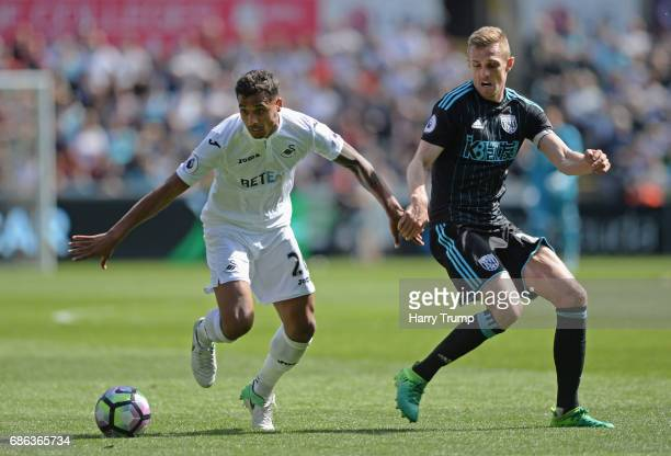 Kyle Naughton of Swansea City and Brendan Galloway of West Bromwich Albion battle for the ball during the Premier League match between Swansea City...
