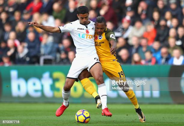 Kyle Naughton of Swansea City and Jose Izquierdo of Brighton and Hove Albion battle for the ball during the Premier League match between Swansea City...