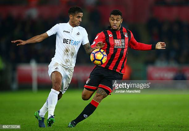 Kyle Naughton of Swansea City and Joshua King of AFC Bournemouth compete for the ball during the Premier League match between Swansea City and AFC...