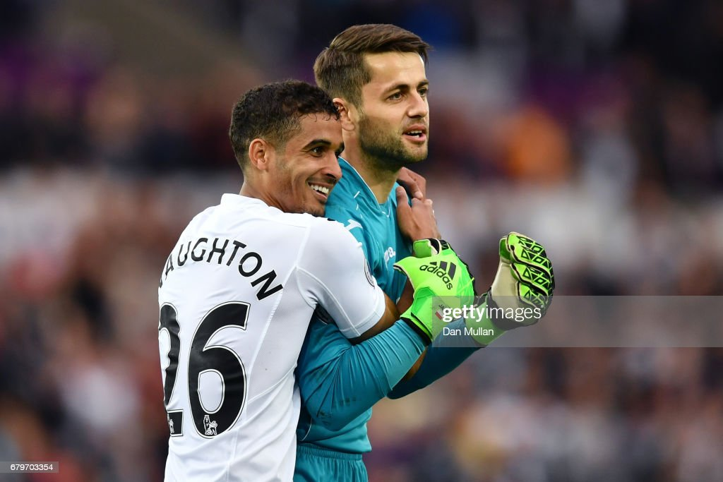 Kyle Naughton of Swansea City and Lukasz Fabianski of Swansea City celebrate together after the Premier League match between Swansea City and Everton at the Liberty Stadium on May 6, 2017 in Swansea, Wales.
