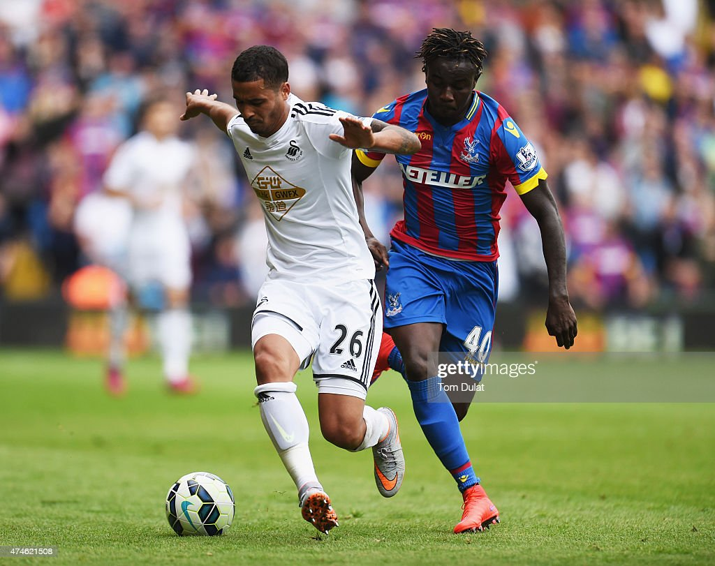 Kyle Naughton of Swansea City and Pape N'Diaye Souare of Crystal Palace compete for the ball during the Barclays Premier League match between Crystal Palace and Swansea City at Selhurst Park on May 24, 2015 in London, England.