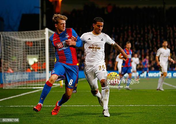 Kyle Naughton of Swansea City and Patrick Bamford of Crystal Palace compete for the ball during the Barclays Premier League match between Crystal...