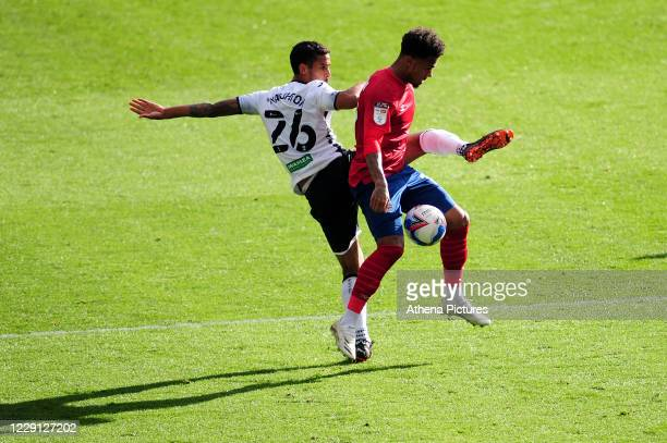 Kyle Naughton of Swansea City battles with Fraizer Campbell of Huddersfield Town during the Sky Bet Championship match between Swansea City and...