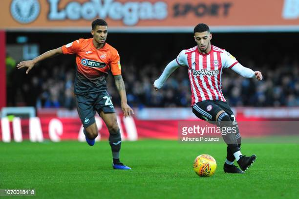 Kyle Naughton of Swansea City battles with Saïd Benrahma of Brentford during the Sky Bet Championship match between Brentford and Swansea City at...