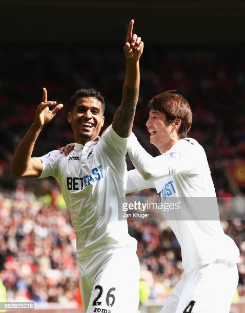 Kyle Naughton of Swansea City celebrates scoring his sides second goal with Ki SungYueng of Swansea City during the Premier League match between...