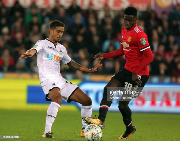Kyle Naughton of Swansea City challenged by Axel Tuanzebe of Manchester United during the Carabao Cup Fourth Round match between Swansea City and...