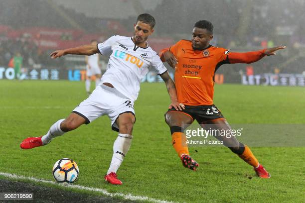 Kyle Naughton of Swansea City challenged by Bright Enobakhare of Wolverhampton Wanderers during the Emirates FA Cup match between Swansea and...