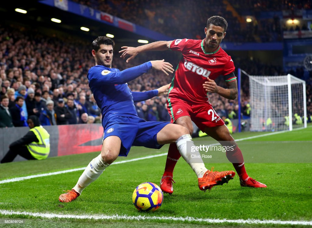 Kyle Naughton of Swansea City challenges Alvaro Morata of Chelsea during the Premier League match between Chelsea and Swansea City at Stamford Bridge on November 29, 2017 in London, England.