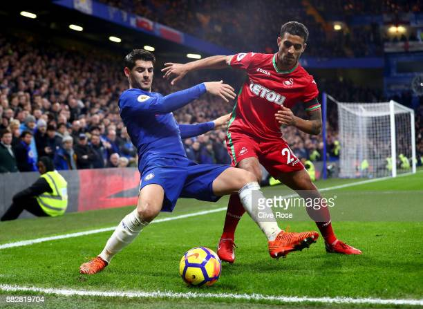 Kyle Naughton of Swansea City challenges Alvaro Morata of Chelsea during the Premier League match between Chelsea and Swansea City at Stamford Bridge...