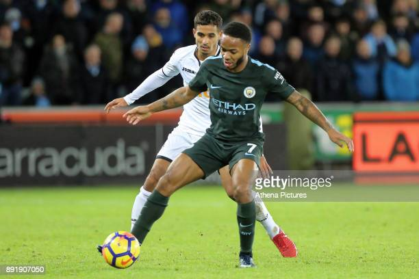 Kyle Naughton of Swansea City challenges Raheem Sterling of Manchester City during the Premier League match between Swansea City and Manchester City...