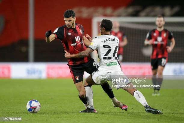 Kyle Naughton of Swansea City holds up Dominic Solanke of Bournemouth during the Sky Bet Championship match between AFC Bournemouth and Swansea City...