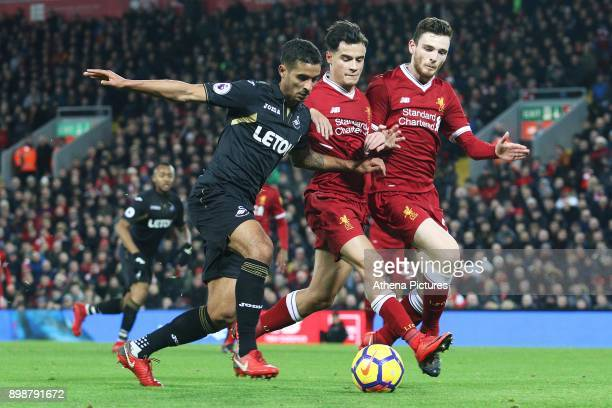 Kyle Naughton of Swansea City is challenged by Philippe Coutinho and Andrew Robertson of Liverpool during the Premier League match between Liverpool...