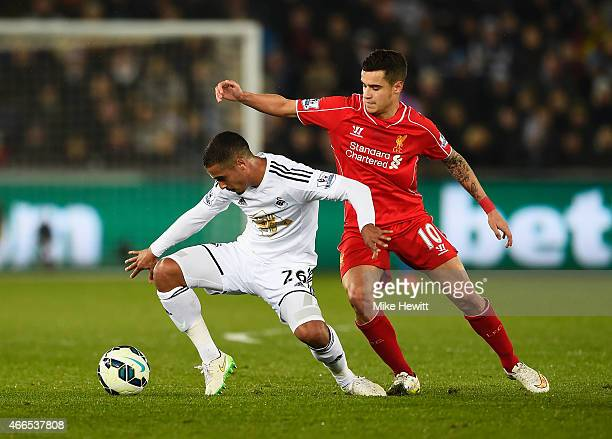 Kyle Naughton of Swansea City is closed down by Philippe Coutinho of Liverpool during the Barclays Premier League match between Swansea City and...