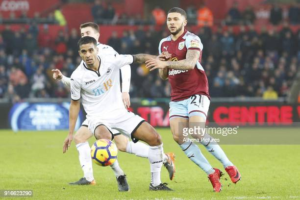Kyle Naughton of Swansea City is marked by Nahki Wells of Burnley during the Premier League match between Swansea City and Burnley at the Liberty...