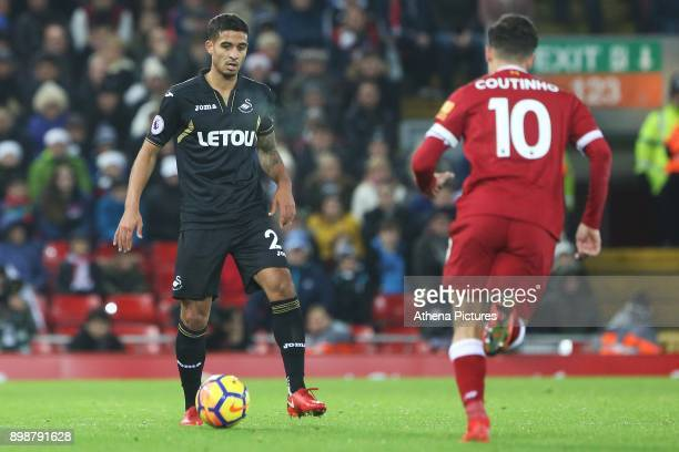 Kyle Naughton of Swansea City is marked by Philippe Coutinho of Liverpool during the Premier League match between Liverpool and Swansea City at...