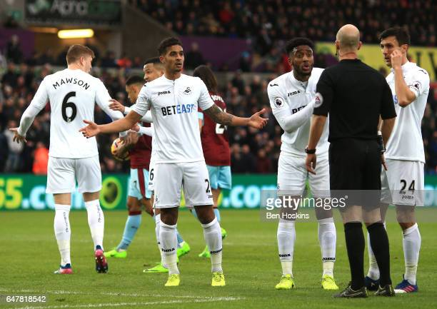 Kyle Naughton of Swansea City Leroy Fer of Swansea City and Jack Cork of Swansea City argue with referee Anthony Taylor during the Premier League...