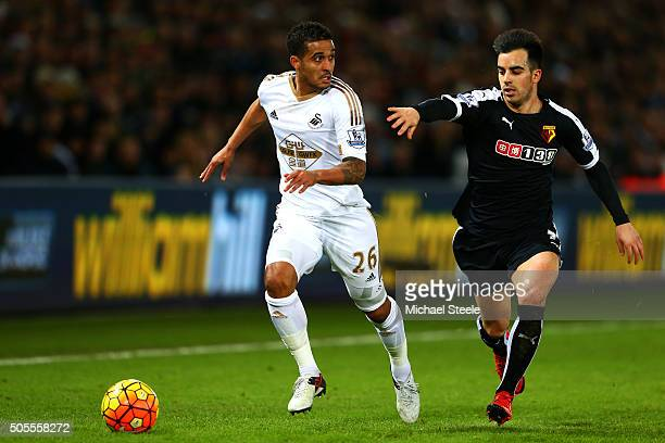 Kyle Naughton of Swansea City runs with the ball under pressure from Jose Manuel Jurado of Watford during the Barclays Premier League match between...