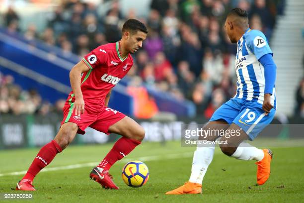 Kyle Naughton of Swansea City runs with the ball under pressure from Jose Izquierdo of Brighton and Hove Albion during the Premier League match...